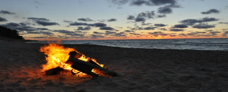 Bonfire on beach at dusk