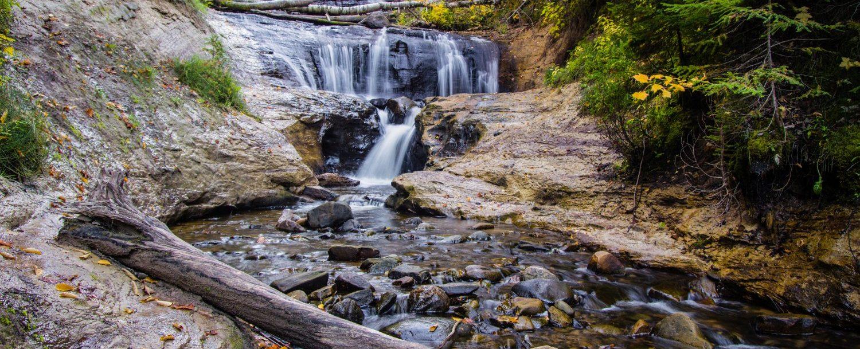 autumn waterfall in michigan near pictured rocks national lakeshore