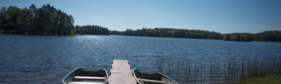 boats on dock by lake, Northern Michigan vacation rentals