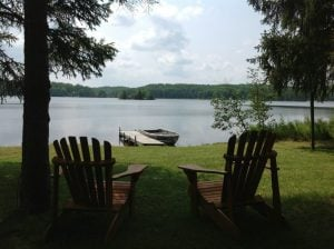 Nettie Bay Resort A2 chair sitting by a lake