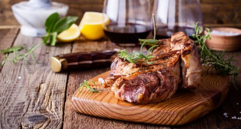 steak and wine on a tray